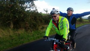 Multi activity adventure weekend including tandem riding - here we have Pilot and stoker on a tandem with stoker arms spread wide after reaching the summit of a hill
