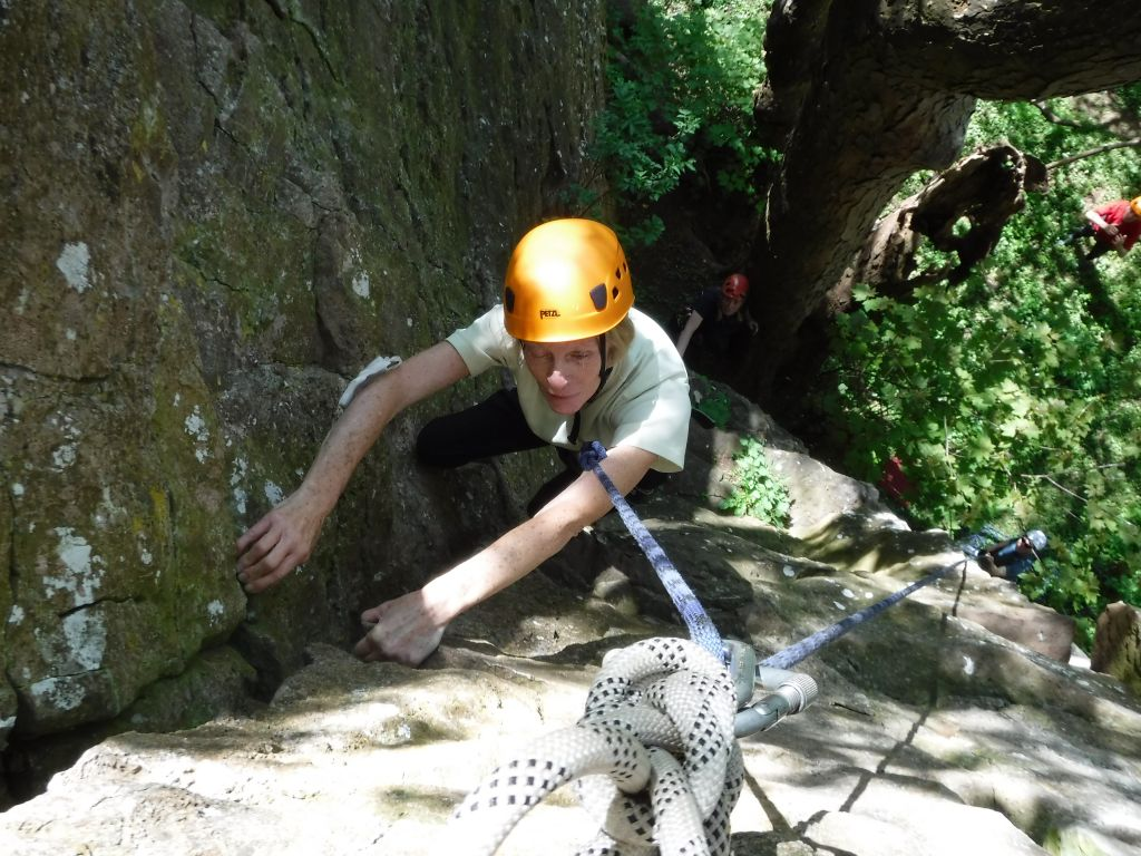 VI climber almost at the top of a corner route in an old sandstone quarry