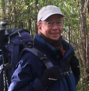 David Newman with rucksack and hiking gear