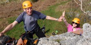 climber with hands aloft after a successful climb