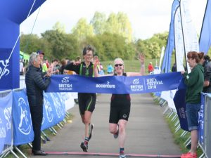 Kath and Andrea inches from the finishing line tape