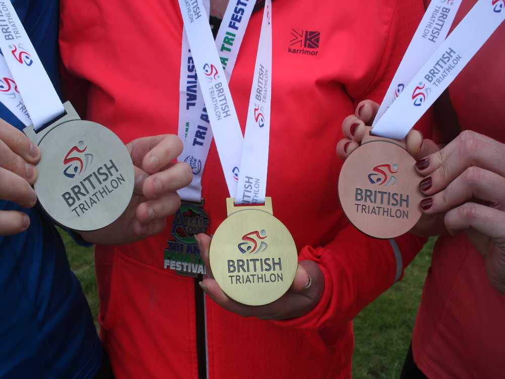 Close up of the 1-2-3 medals