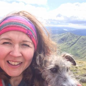 Fran and her lurcher campanion Willow on a Lake District ridge